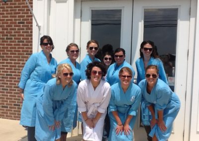 bridal party posing in front of Details Salon & Spa in Mount Joy, PA