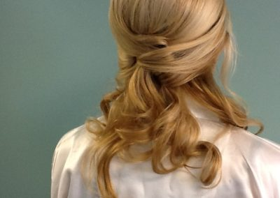 Woman with long blonde hair displays a formal bridal hair style created by Details Salon in Mount Joy, PA