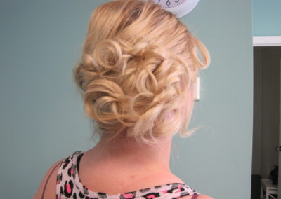 formal updo and styling for a woman with blonde hair at Details Salon