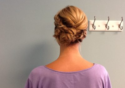 formal updo and braids for a woman with long blonde hair at Details Salon