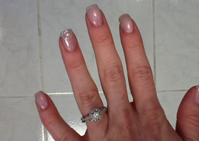 Gel manicure with glitter accessories completed at Details Salon in Mount Joy, PA