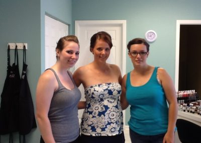 three person bridal party poses after their bridal hair updos and makeup are completed at Details Salon & Spa in Mount Joy, PA
