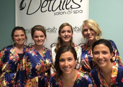 a bridal party of six women posing after receiving top-notch women's haircuts in Mount Joy, PA