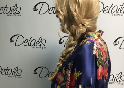 profile of a long braid and loose hairstyle created at Details Salon & Spa in Mount Joy, PA