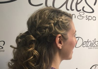 profile view of a braided and curly hairstyle created by Details Salon in Mount, Joy, PA