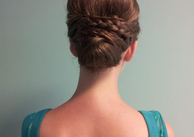 the back of a Details Salon & Spa customer's formal up-do