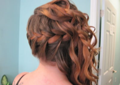 the back of a woman's haircut and up-do at Details Salon in Mt. Joy, PA