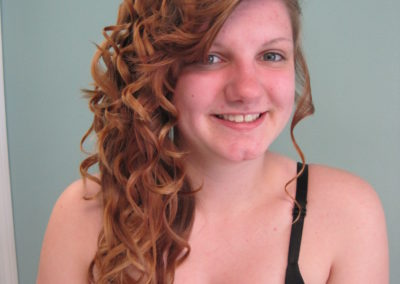customer of Details Salon in Mt. Joy, PA with a long curly women's haircut