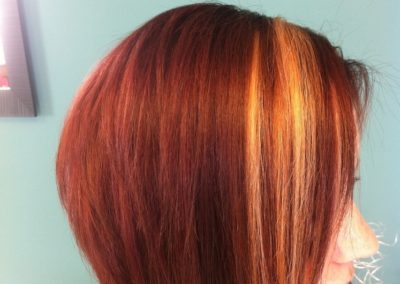 women's haircut and color - auburn red with blonde accents completed by Details Salon