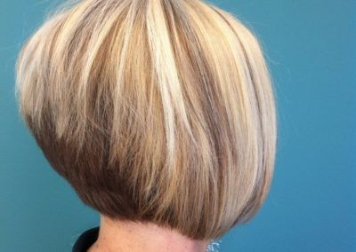 women's haircut and color - blonde with highlights on a crop hairstyle completed by Details Salon
