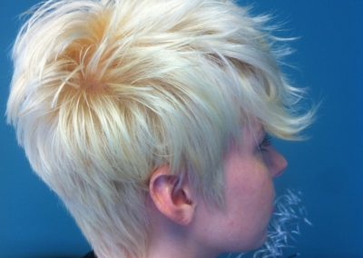 angled view women's haircut and color in Mount Joy, PA - short blonde, trendy style