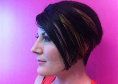 profile view women's haircut and color in Mount Joy, PA - short dark hair