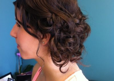 formal updo with many loose curls for a woman with long dark hair at Details Salon