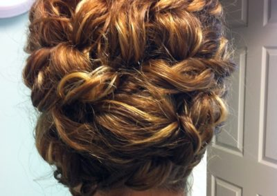 formal updo with many curls for a woman with long dark hair at Details Salon