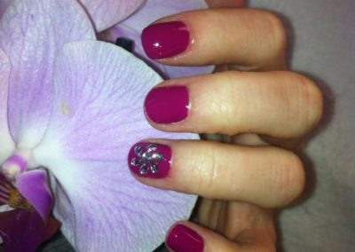 Red gel manicure with glitter accessories completed at Details Salon in Mount Joy, PA
