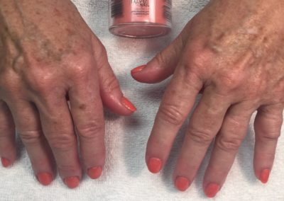 close up of hands with peach revel nail polish finished at Details Salon Mount Joy, PA nail salon