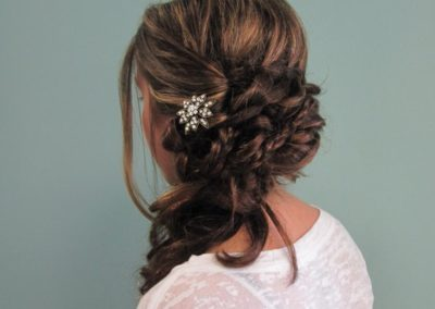 Details Salon customer displays her prom hairstyle and hair accessory