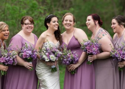 A professional bridal photo of a group of women who had their wedding updos done at Details Salon in Mount Joy, PA